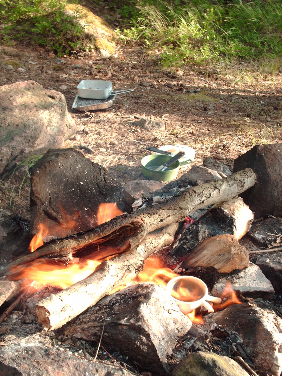 Bicycle touring cuisine: cooking breakfast on a campfire before a long day in the saddle.