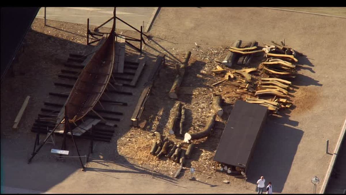 Aerial view looking down on the Viking shipyard, Roskilde Museum, Denmark with stored timbers and a ship awaiting completion on the stocks