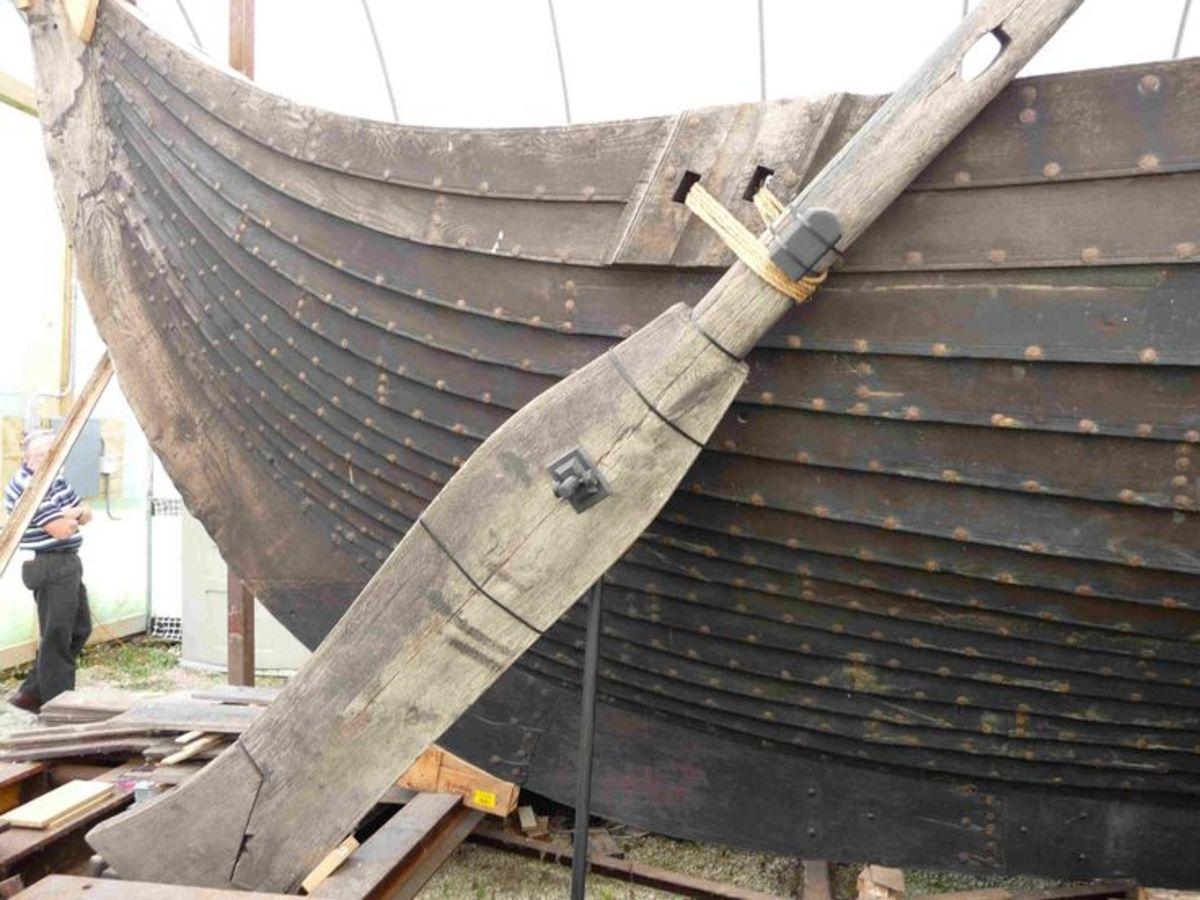 The steering oar or tiller, 'Sea Stallion', set on the starboard quarter - starboard comes from 'steerboard'