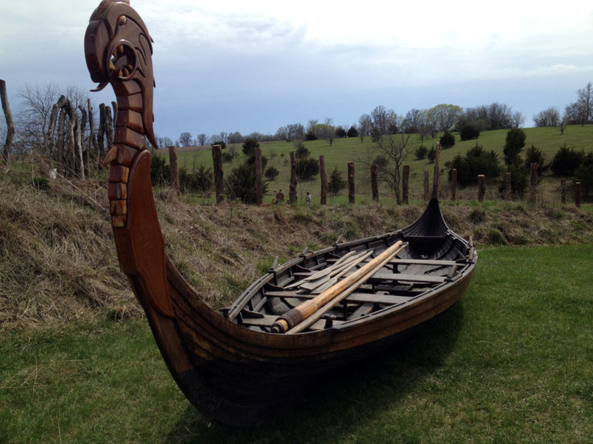 A 'karve' or launch with high dragon prow. A karve would usually be built for noblemen or kings to ferry them to their drakkar or warships, maybe to the next fjord on a social visit
