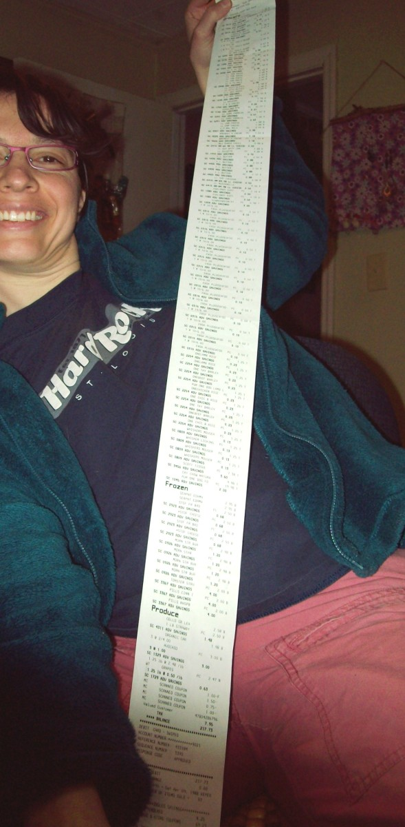 This is me happily holding a very long receipt...and I saved almost $74 on this trip, with no coupon clipping.  I had only used a few coupons issued by the store.