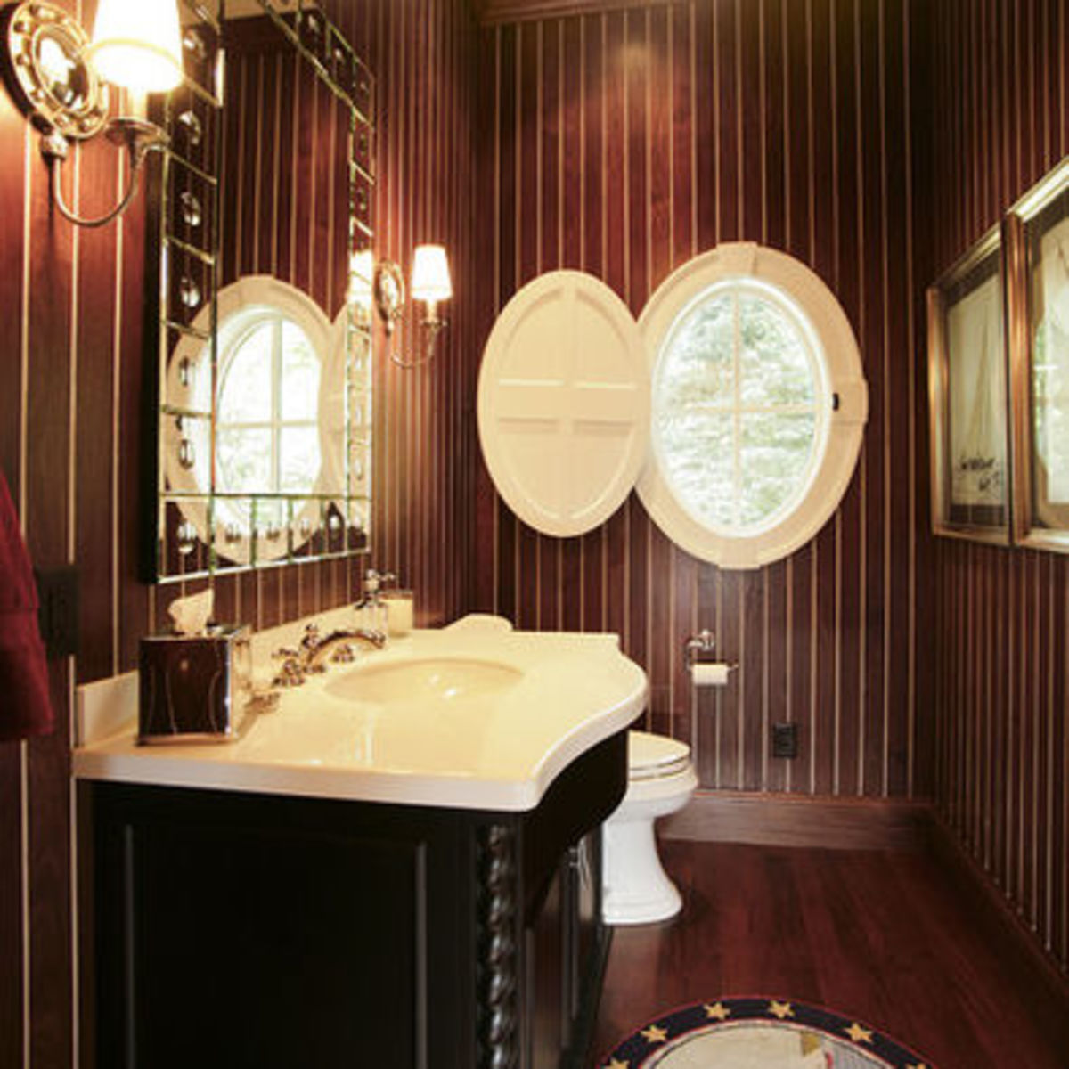 Nautical bathroom with walls made of wood boat flooring and an Oval Port Hole