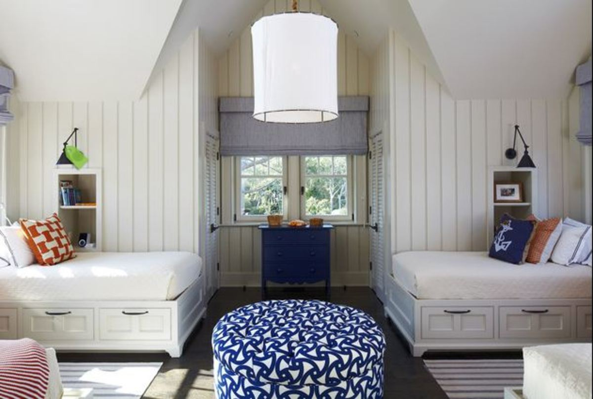 Nautical Bedroom with twin beds that include storage drawers in white