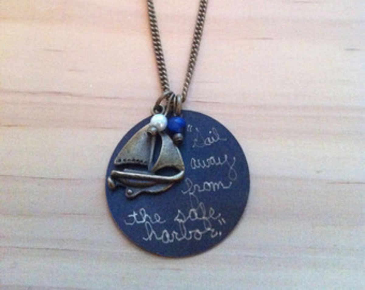 silver and blue necklace pendant with Mark Twain motivational quote - sail away from the harbor