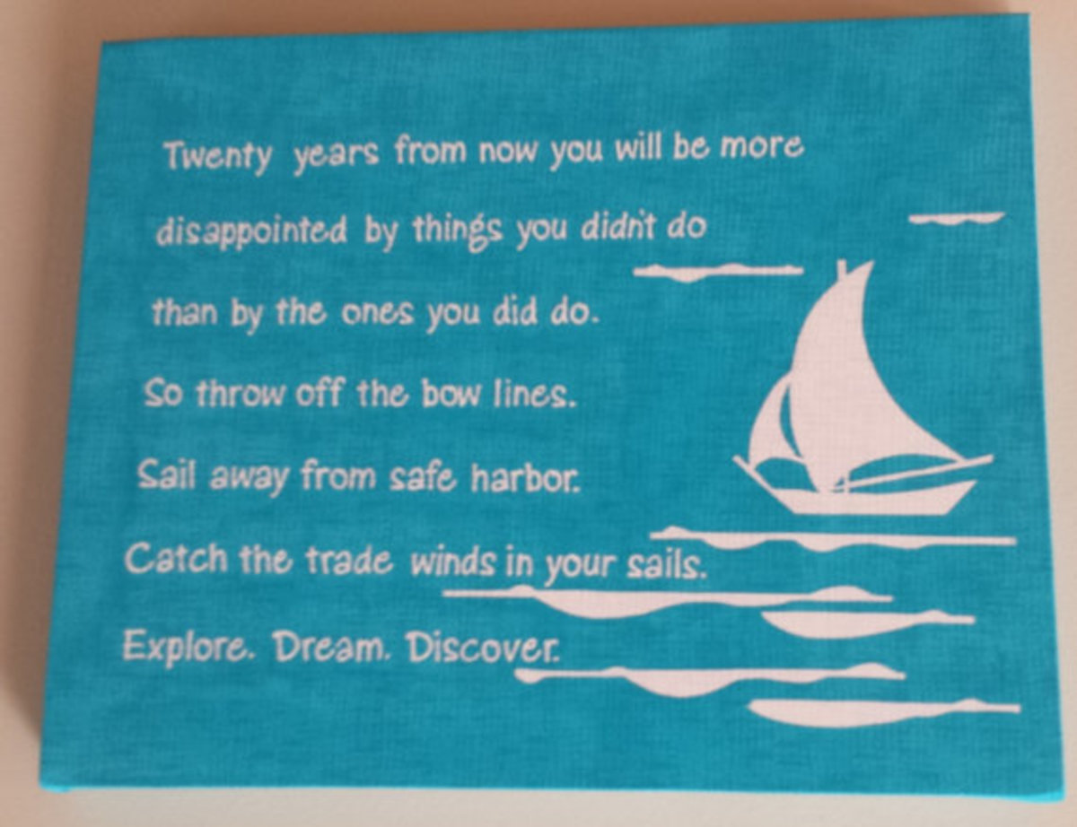 blue and white canvas poster with sailboat detailing to dream and explore