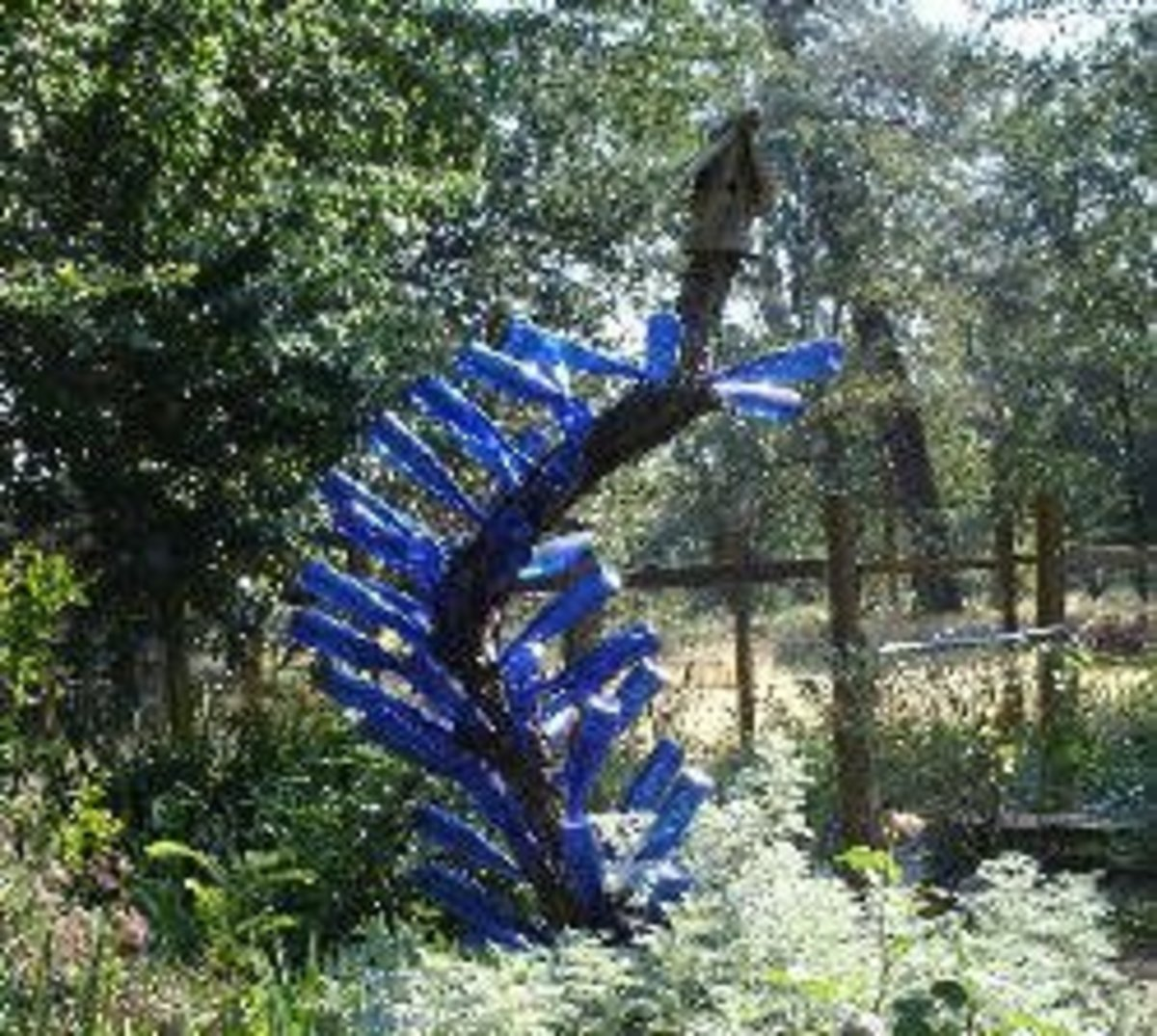 A really neat and unusual bottle tree.Note that it is made of the popular blue bottles.