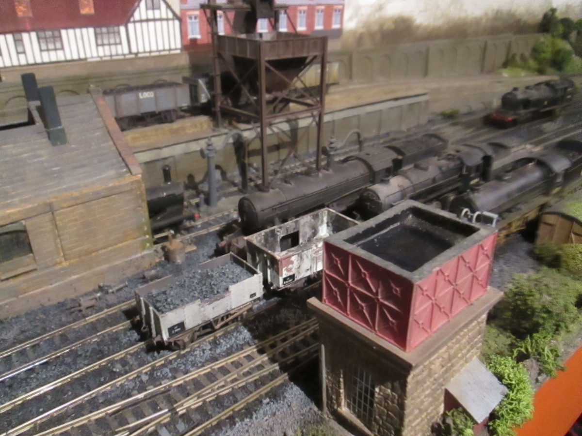 The Hornby Skaledale water tower (bottom right) was modelled on the Goathland prototype. Across the way is the modified loco coaler