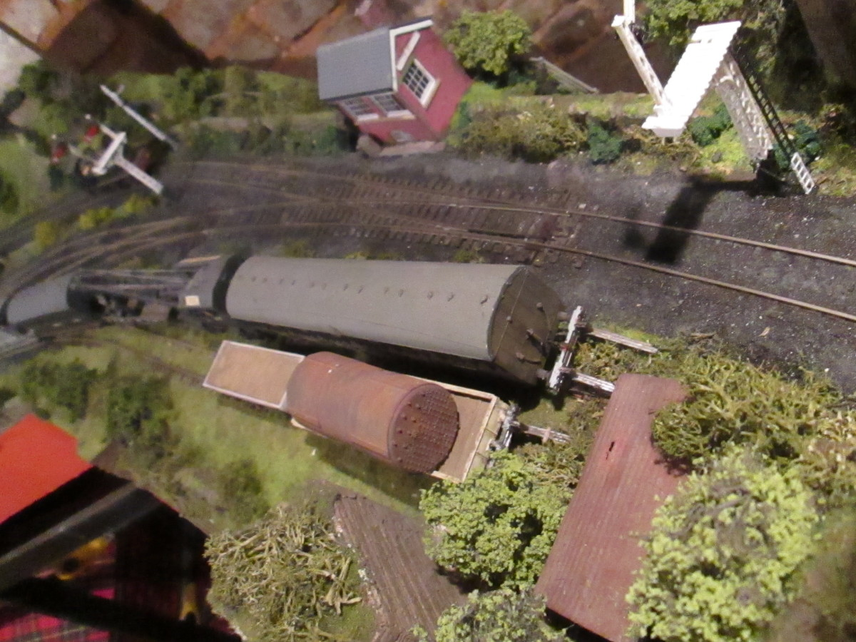 Above the cattle creep, the engineer's train rests in the siding next to the 'cripples' road. See the old boiler on the nearside wagon? (No, not the mother-in-law!)