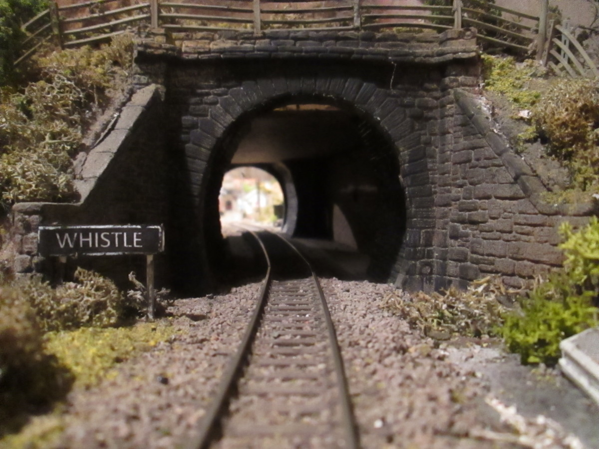 The tunnel from Thoraldby's side. No danger of being run over... Uh-oh, I dunno though. Something's rumbling under my feet. I've probably been looking the wrong way. 'Whistle' board has been moved forward - prototypically - since this view was taken