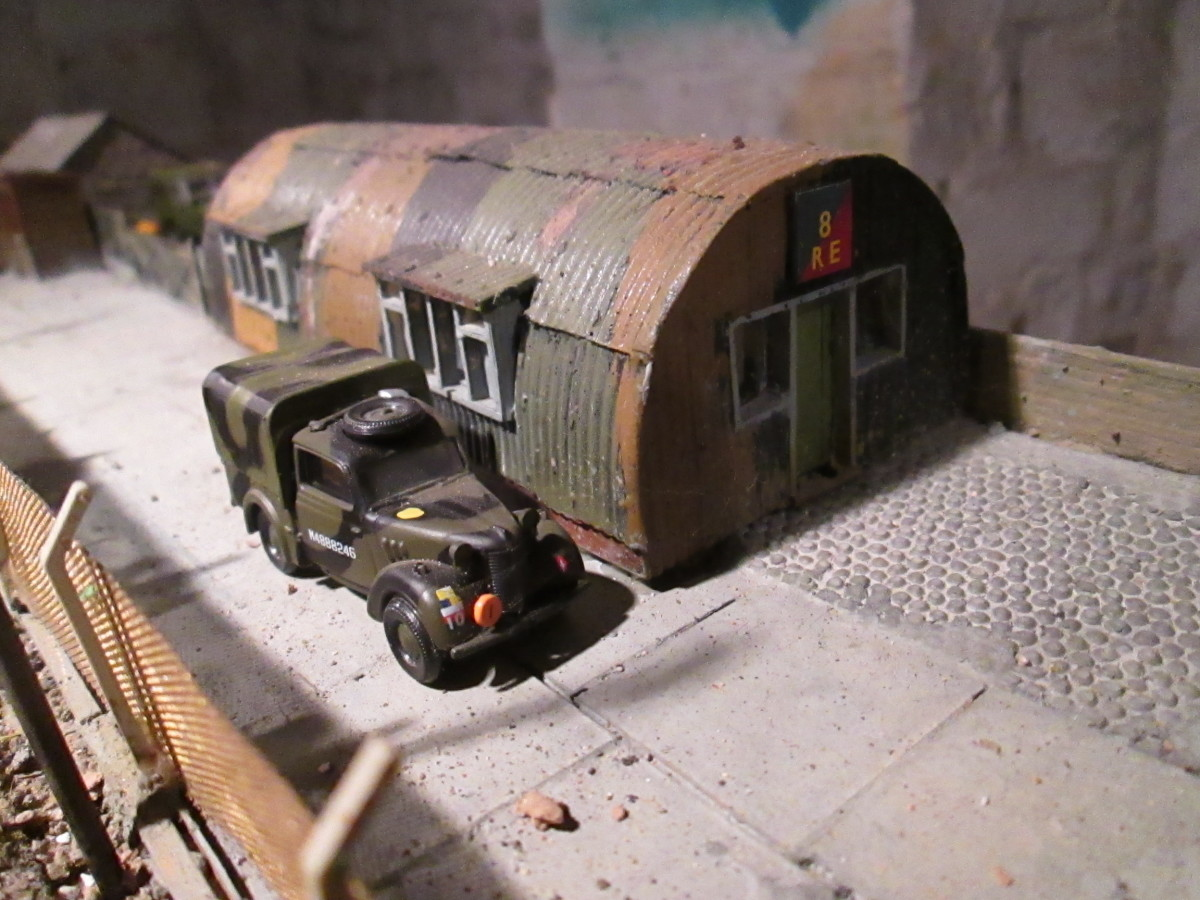 Royal Engineers' store: One of the two Nissen huts within the camp next door to the station; tarpaulined army vehicle passing (Oxford 4mm scale model).