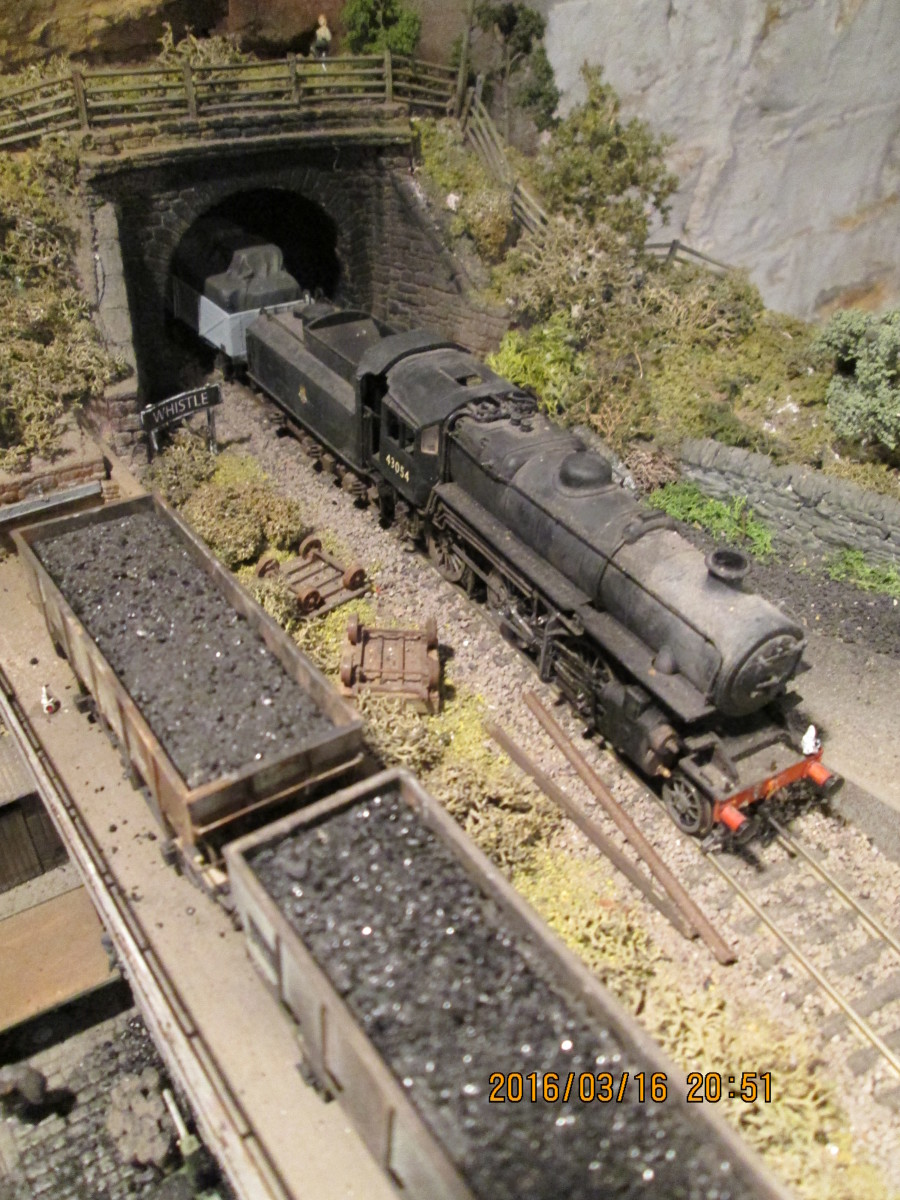 (Seen before the addition of the shed for the Bachmann Branchline Wickham Gangers' Trolley):With an unfitted branch goods working 43054 emerges from the tunnel adjacent to Thoraldby's coal depot