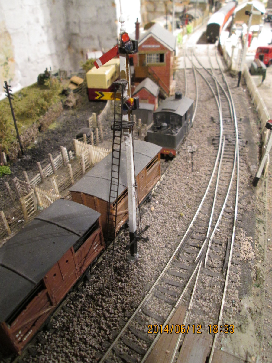 The path is set for the next 'up' working. Here we are looking past the 'up' home at 'off'', down at the livestock dock. Through running line centre, coal depot siding on the right