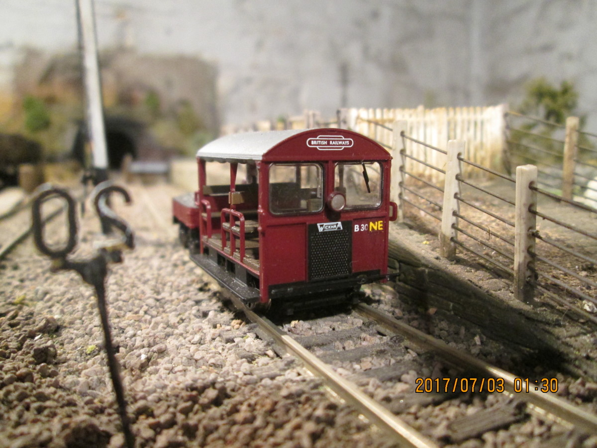 That Wickham Gangers' trolley has undergone a small identity change, the regional 'W' replaced by 'NE'; parked on the livestock dock/machine ramp road by the signal cabin - just needs a driver