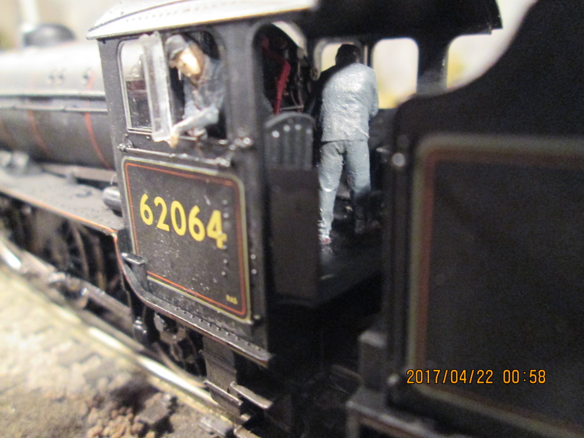 Here's the Model-U driver of Stockton-on-Tees K1 62064 looking back at the photographer during a signal check near Thoraldby. In the lull, fireman tops up the coal in the firebox