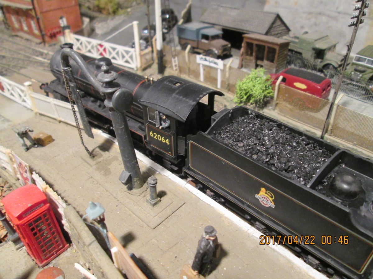 Bird's eye view of 62064 beside the water crane. The following train will be a local (stopping) passenger working