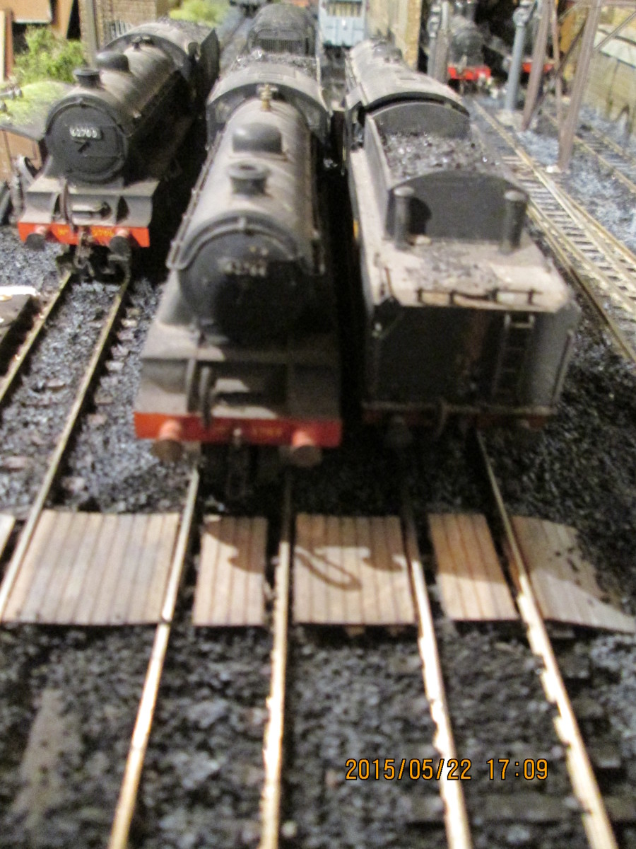 L-R, 1980's Hornby D49 62700 almost out of sight, Almost on the 'Poppy's timber barrow crossing are modified D49/2 62764  'The Garth' (from D49/1) and Bachmann WD 2-8-0 90446 (see below for contact link to Poppy's for a list of balsa model products)