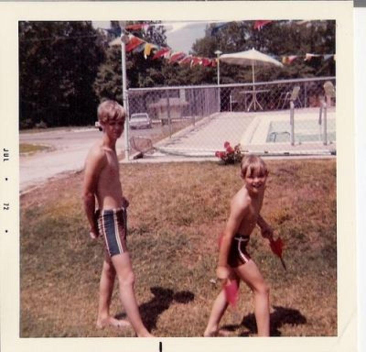 Two boys playing lawn darts in the 1970s
