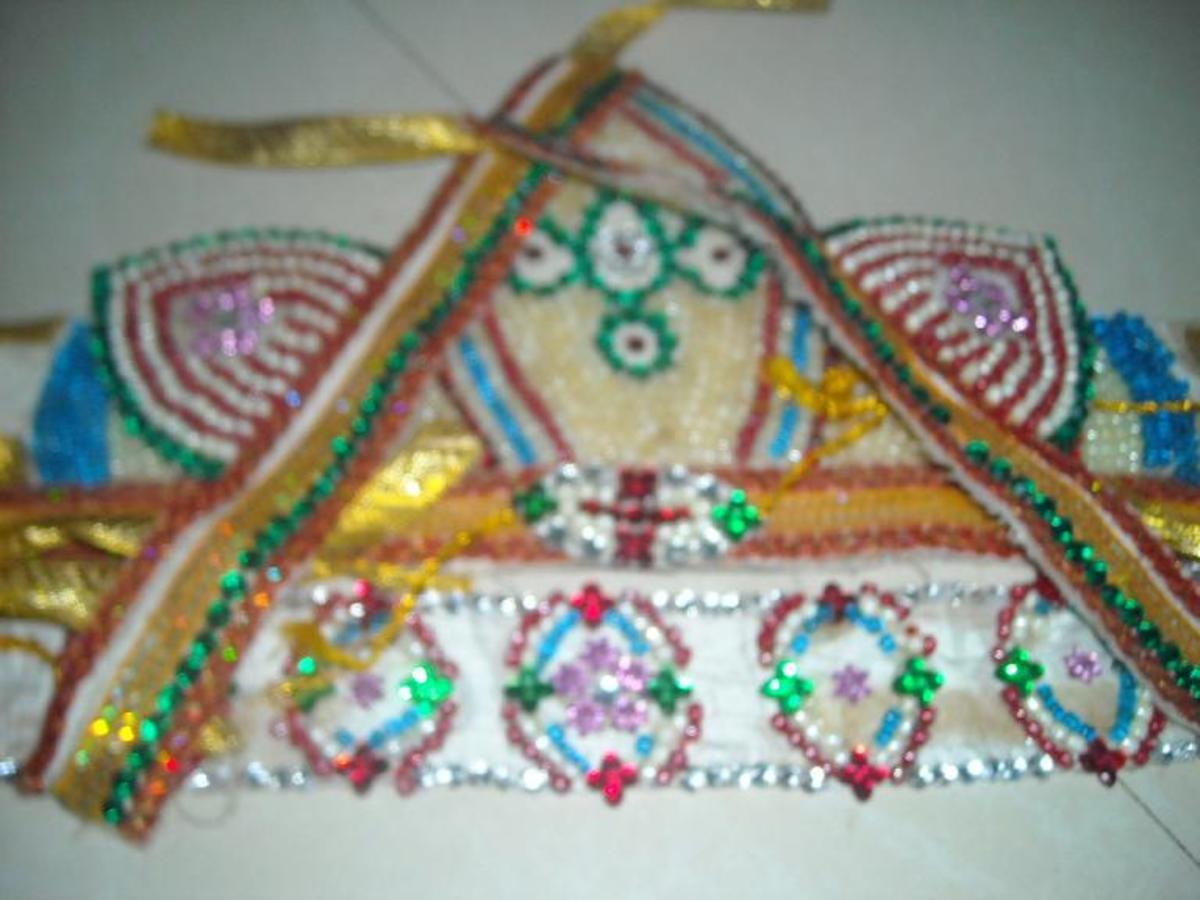 Crown, armlets, bracelets and waist band