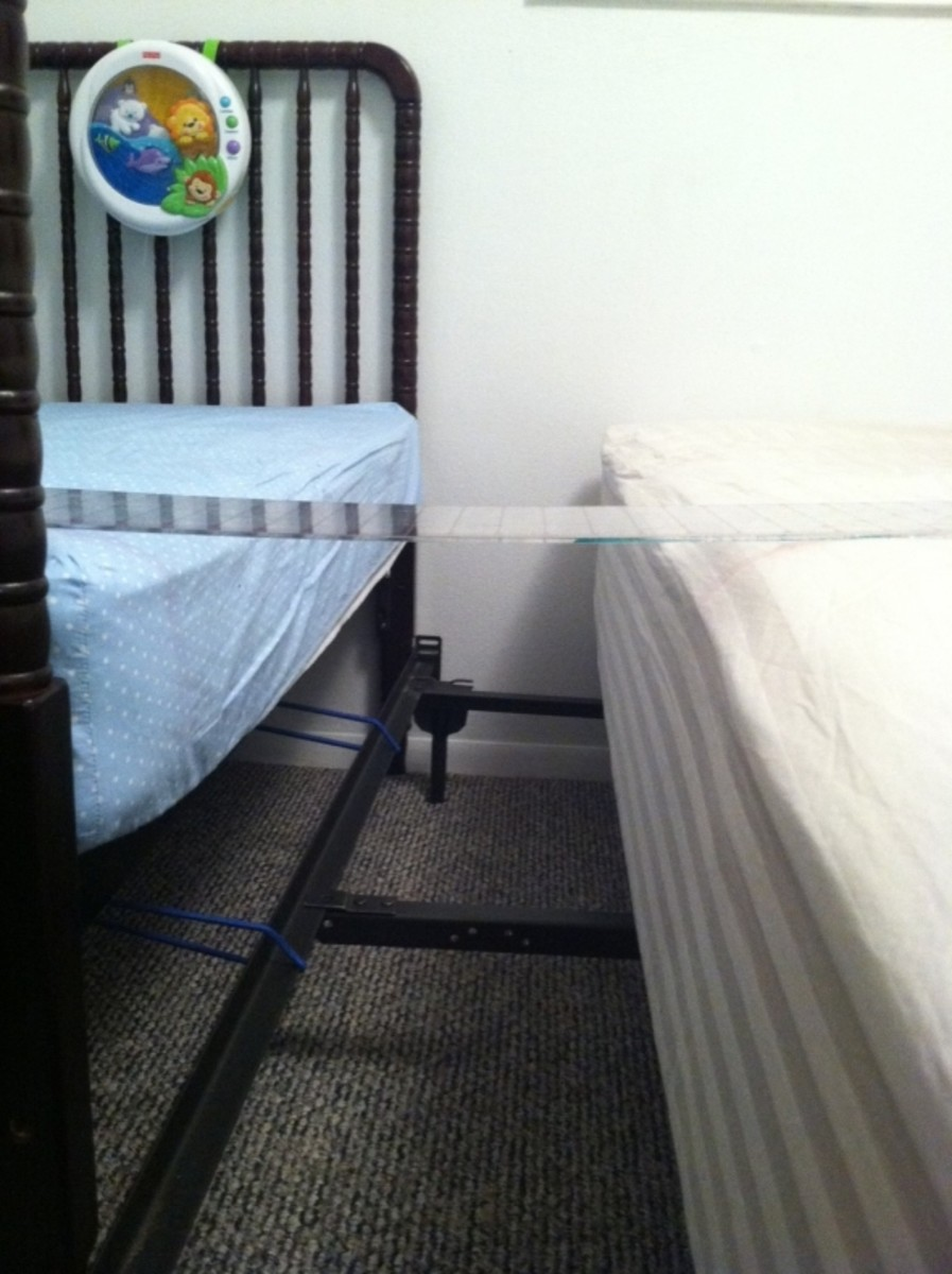 Make the tops of both mattresses level by adding/removing bed risers, casters, etc.