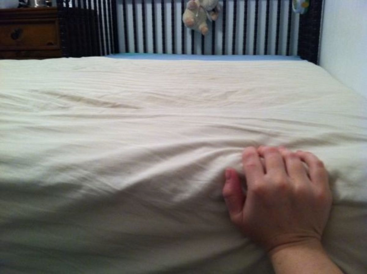 Push the bed as close to the crib as possible, to eliminate the crack.