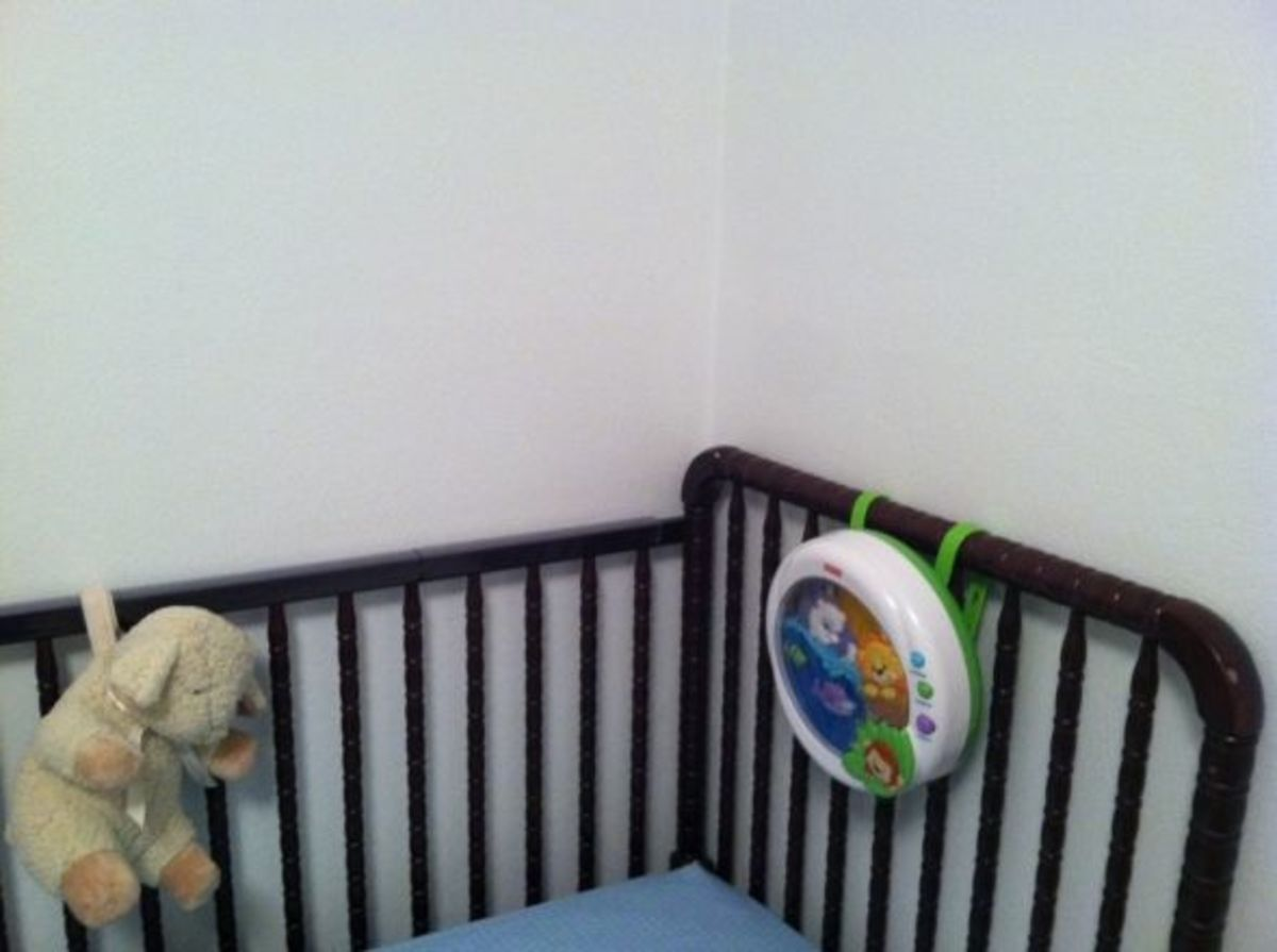 Push the crib flush against the wall.