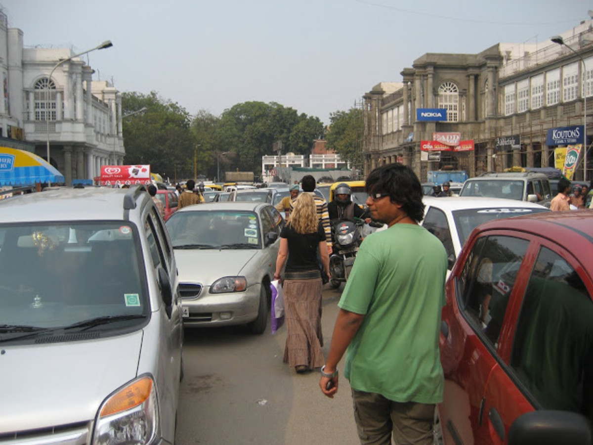 Cannaught Place in Delhi. These all are standard transmission cars driving here. This is something known as bumper to bumper traffic where there is just a finger space between you and the car behind and front of you making 1st gear very important.
