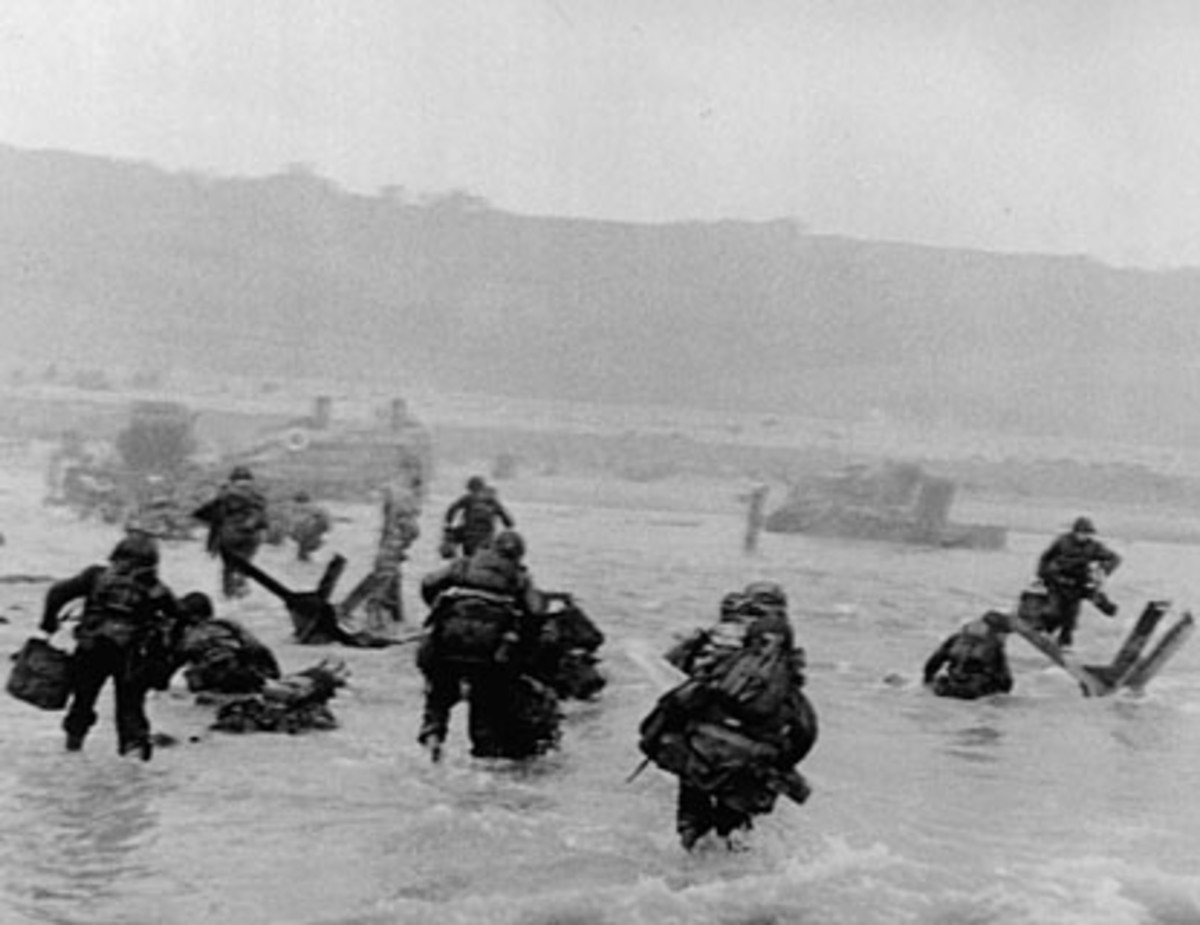 Soldiers scrample to get out of the water while under fire.