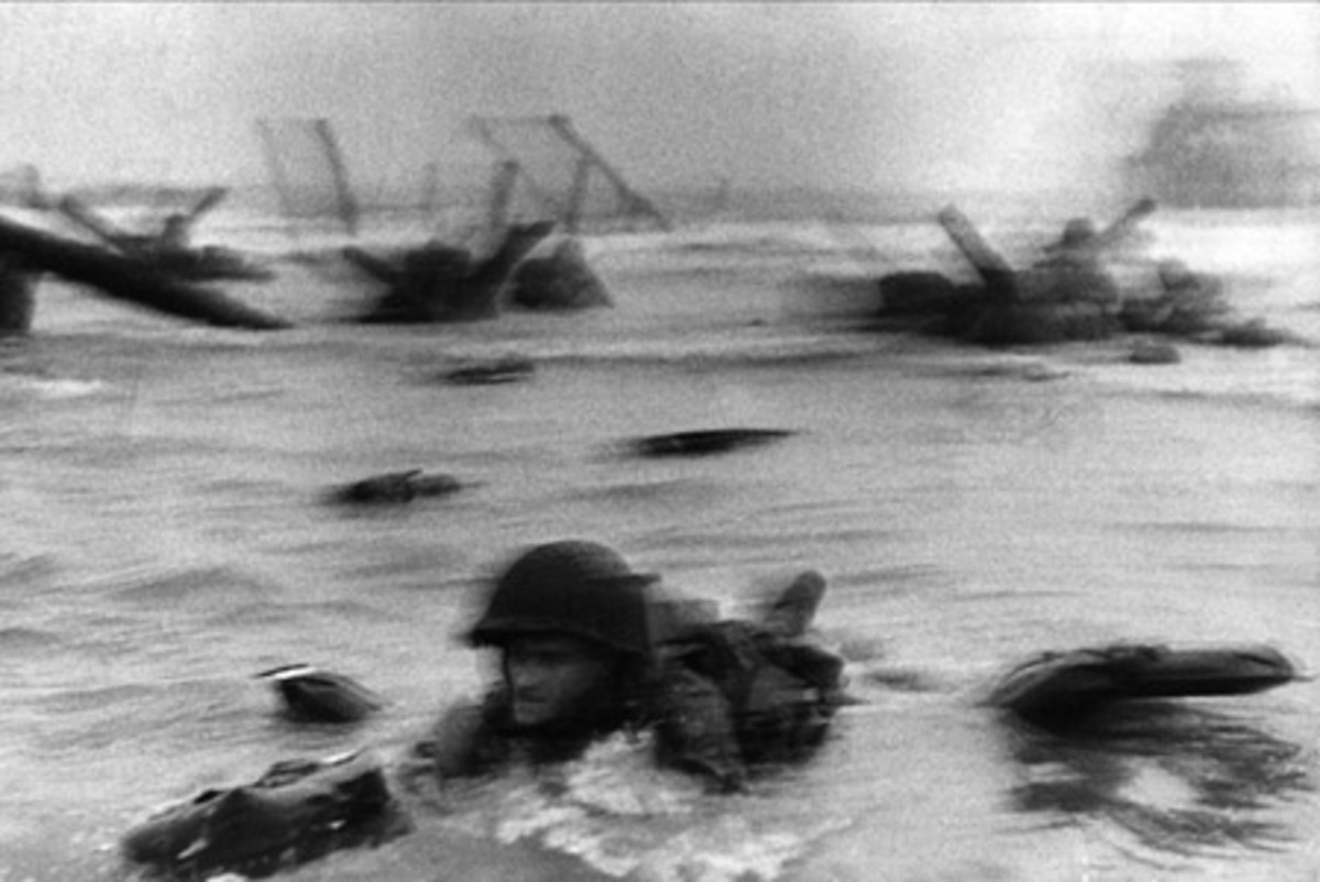 An epic photograph of a soldier swimming towards shore.