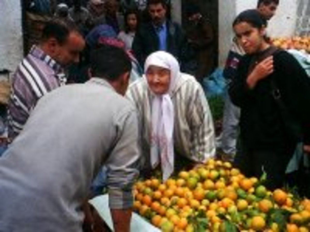 Language. Haggling in the market in Morocco.