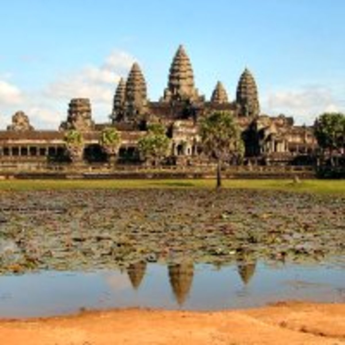 The Angkor Wat temple ruins stand at the center of a UNESCO World Heritage Site in modern Cambodia. Built in the twelfth century, it remains the largest religious building in the world.