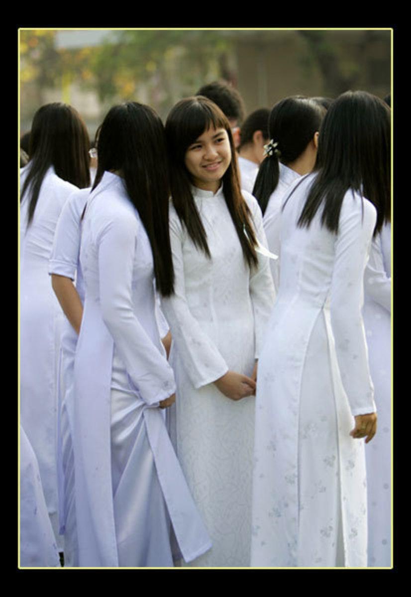 White ao dai as uniform for female student.
