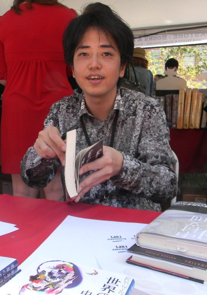 Nakamura Fuminori signing books at the 2013 Los Angeles Festival of Books.