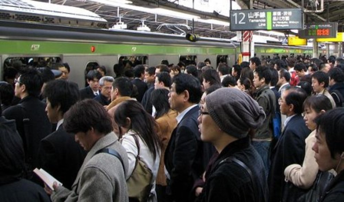 Shinjuku Station. Morning commuters hoping to board a train that's already full