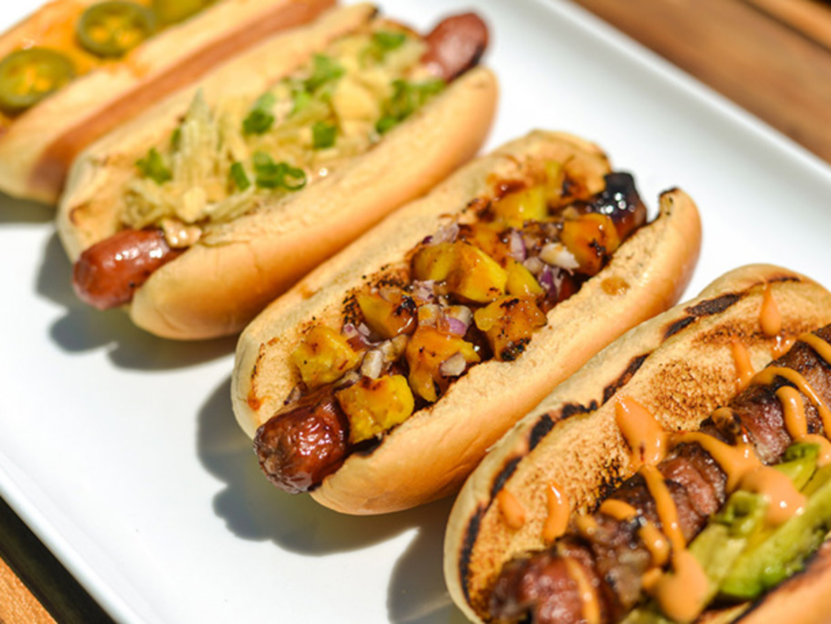 Always butter and grill your hot dog buns and offer various toppings so everyone can enjoy their hot dogs.