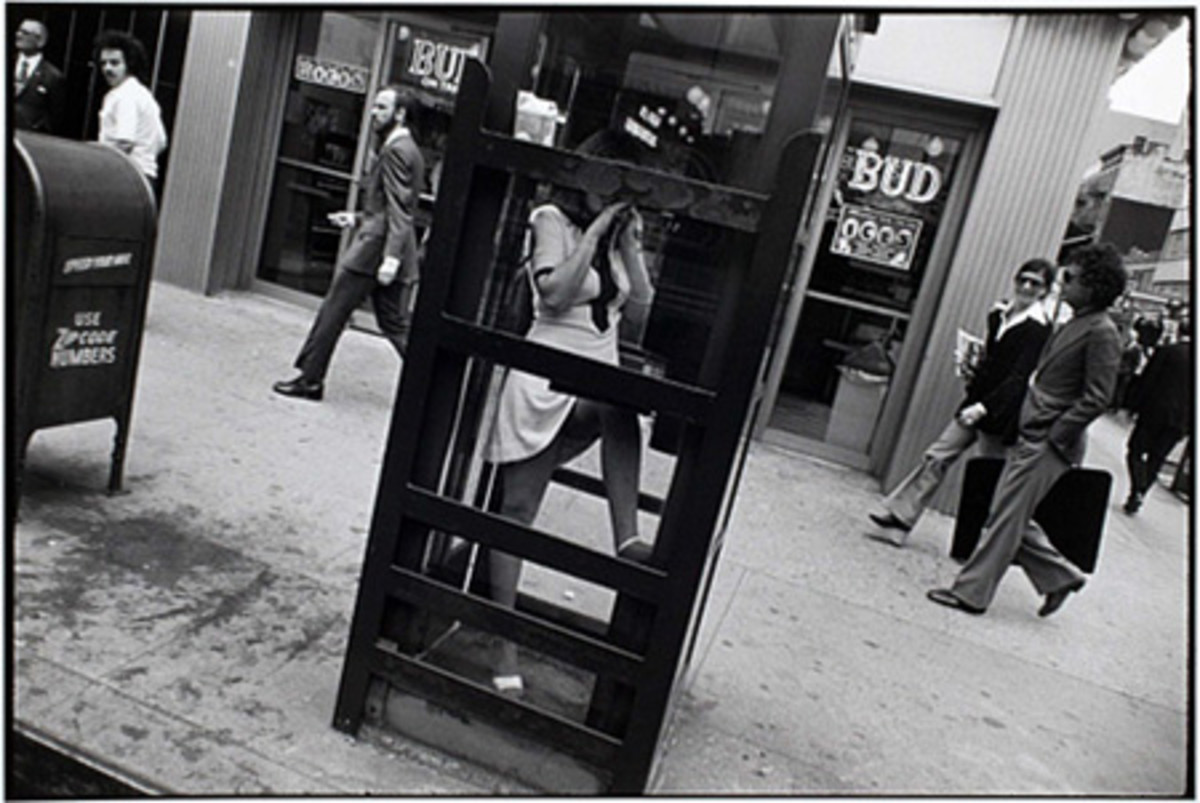 "GARRY WINOGRAND ""GIRL IN PHONE BOOTH WITH LEG UP 1970"""