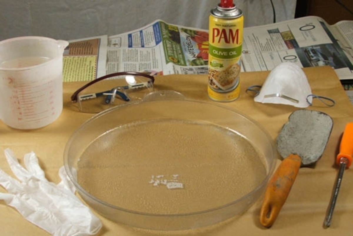 Set up your work area using newspapers or a plastic tarp to protect your table.  Organize all of the materials and tools you will be needing so that they are easy to find and within reach.  Using either a vegetable spray or oil, lightly cover the ins