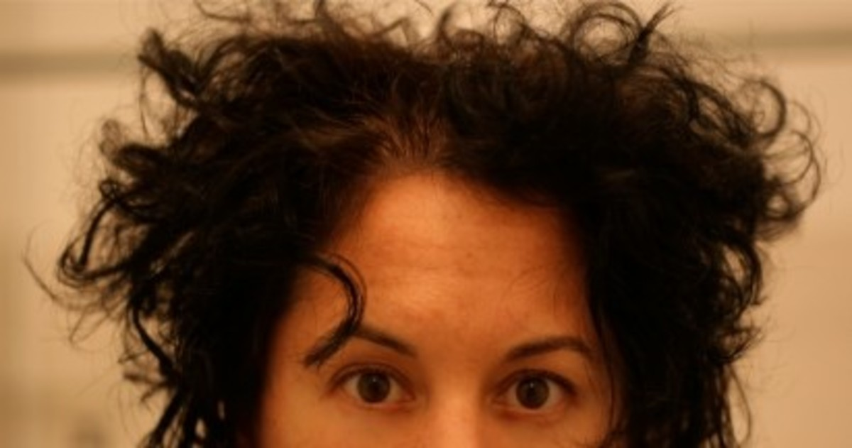...VERY curly, dark brown hair. She has big dark eyes, and she looks rather surprised!