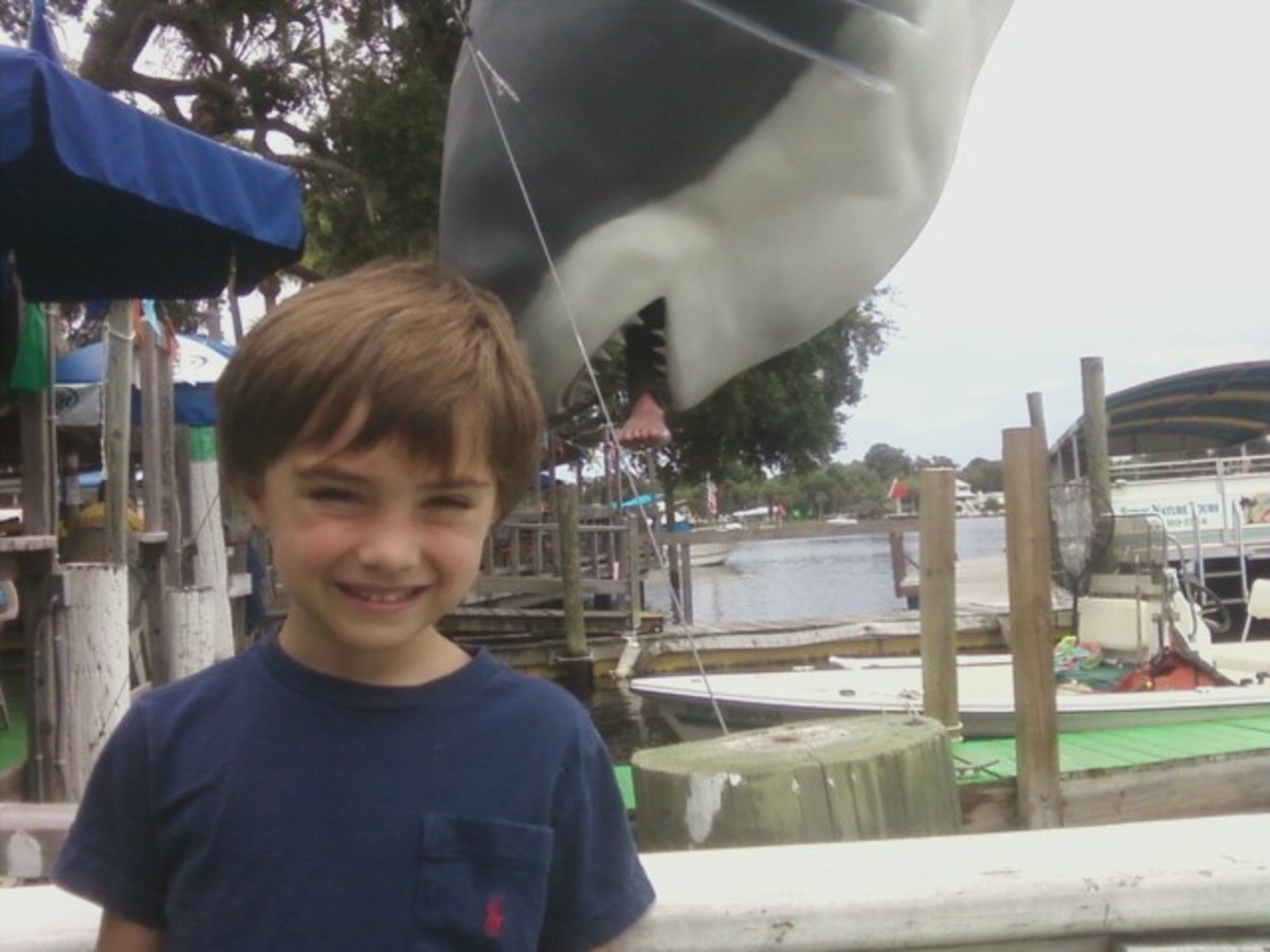 "Tristan in front of the ""man eating"" shark."
