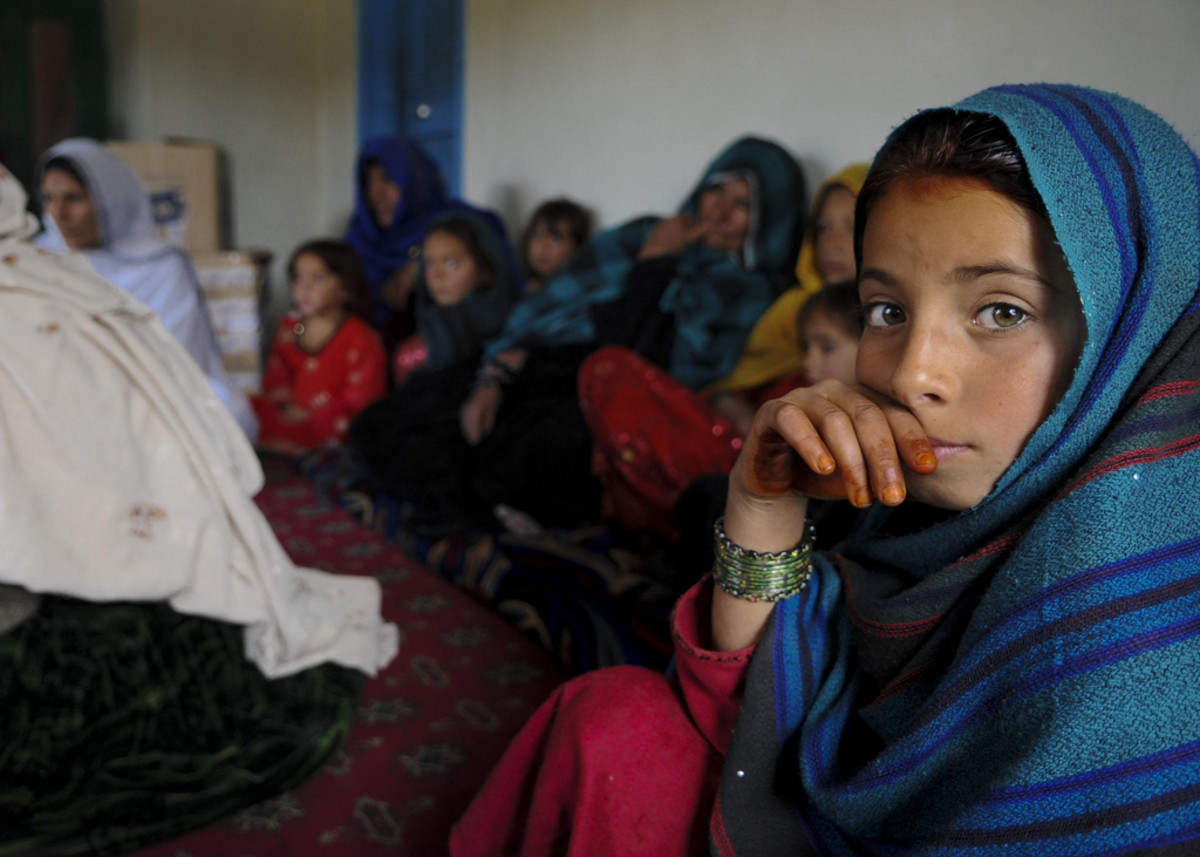 An Afghan girl attends a female engagement team meeting in Balish Kalay Village, Urgun District, Afghanistan. Women and children attended the meeting with the FET of Paktika Provincial Reconstruction Team to discuss major issues and concerns.