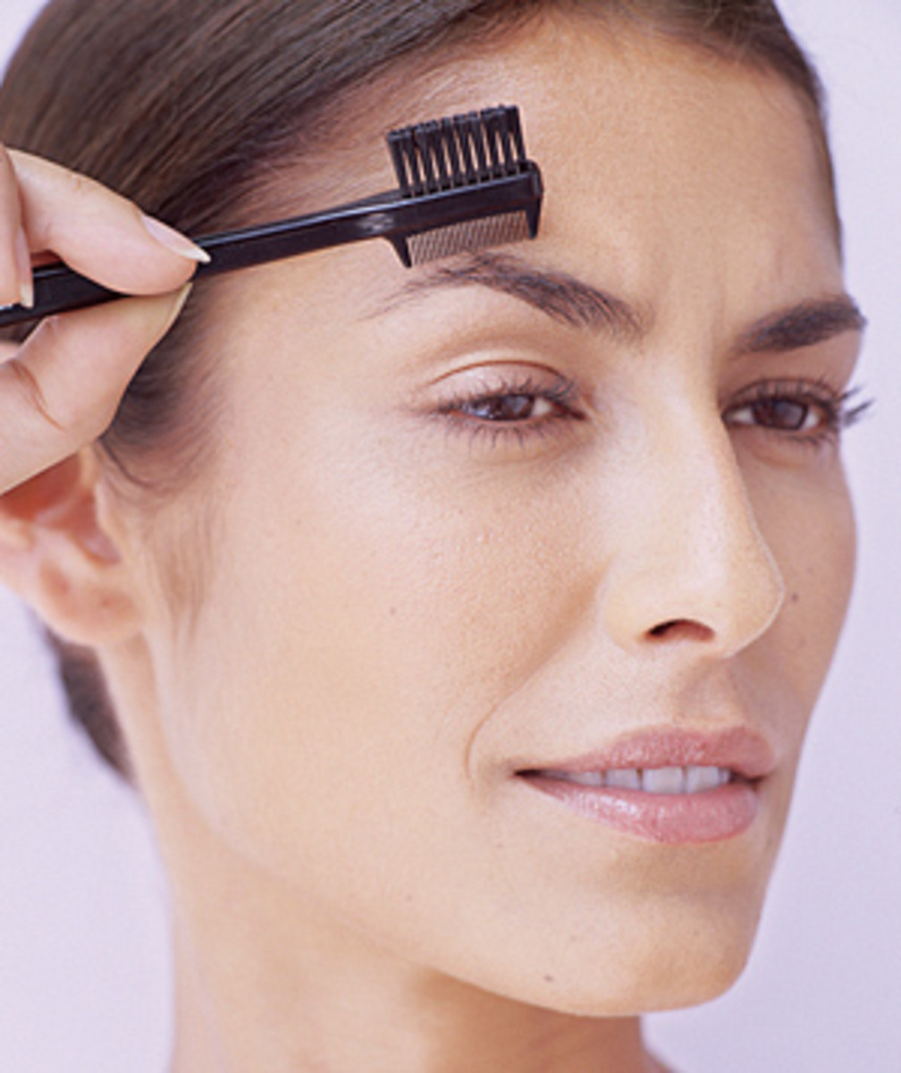 Use eyebrow brushes to groom your eyebrows.