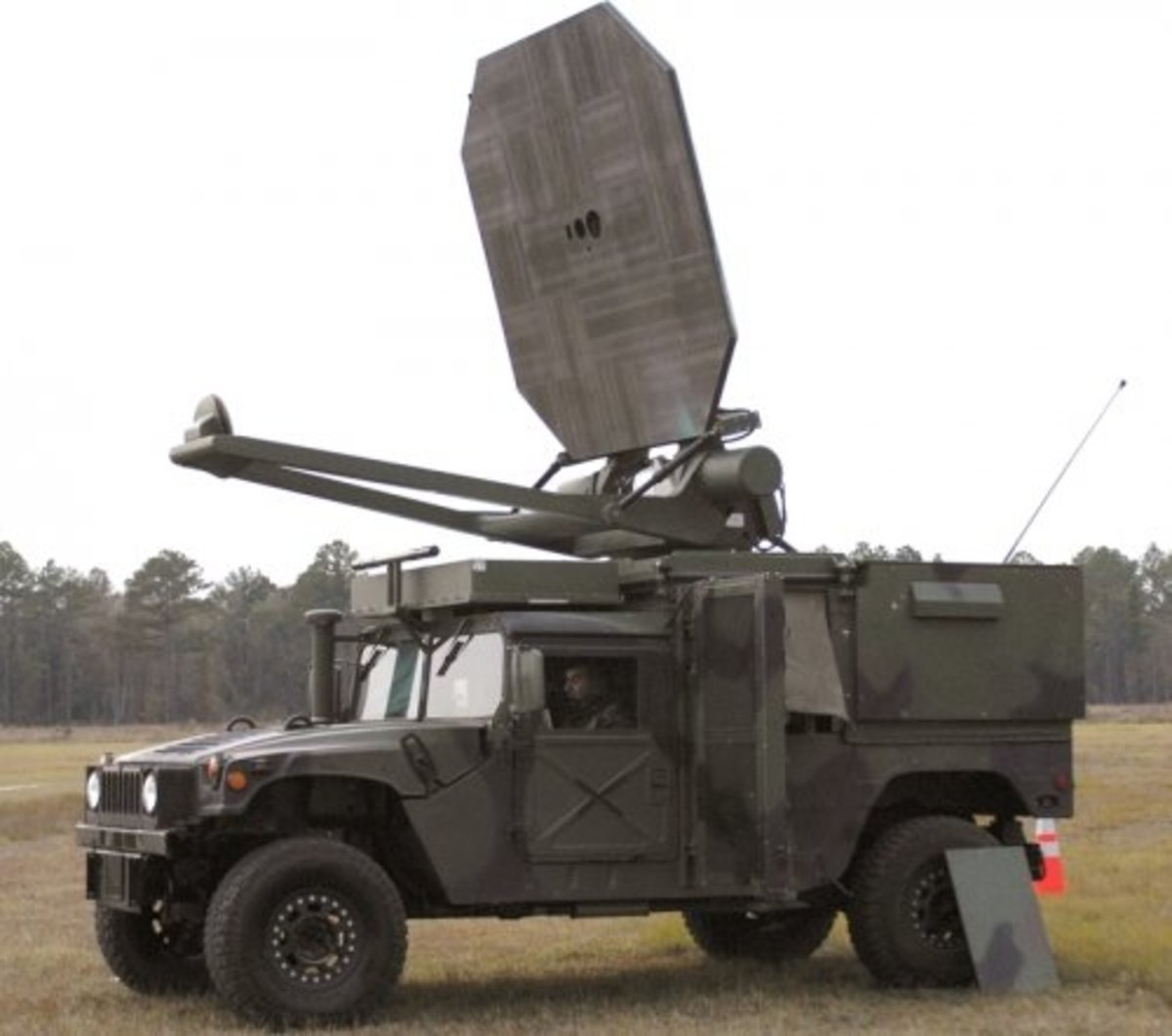 Though not an EMP weapon, this however is a microwave beam weapon in use in battle fields. As a beam weapon it can be aimed and focused on a specific target and cook it from the inside out like a microwave oven. This is used on enemy combatants and c