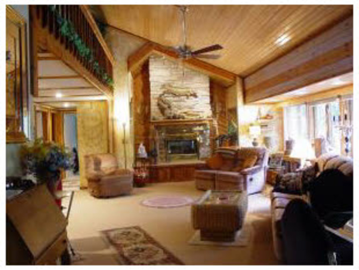 beautiful wood ceiling in living room with ceiling fan and fireplace