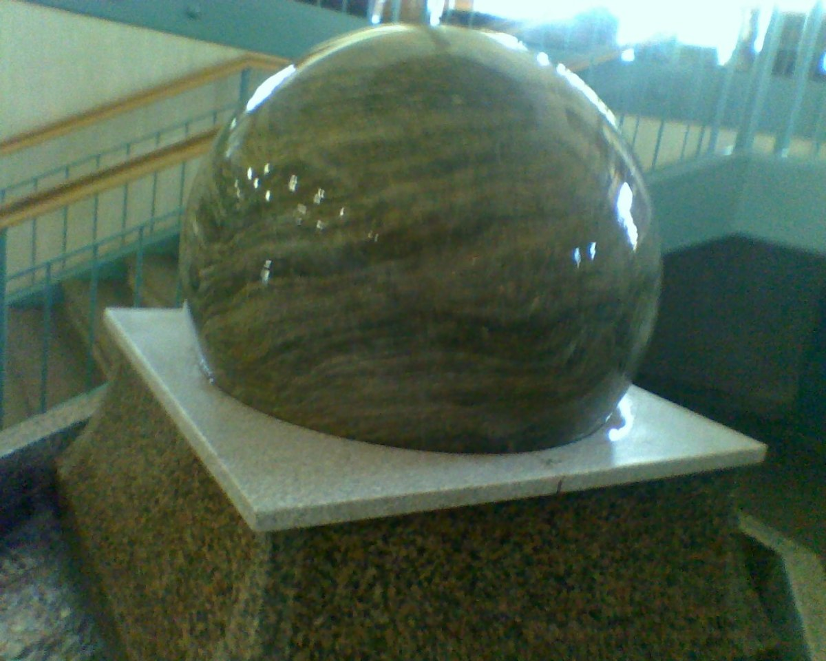 Giant marble ball fountain in the building with the Christmas Tree Shop