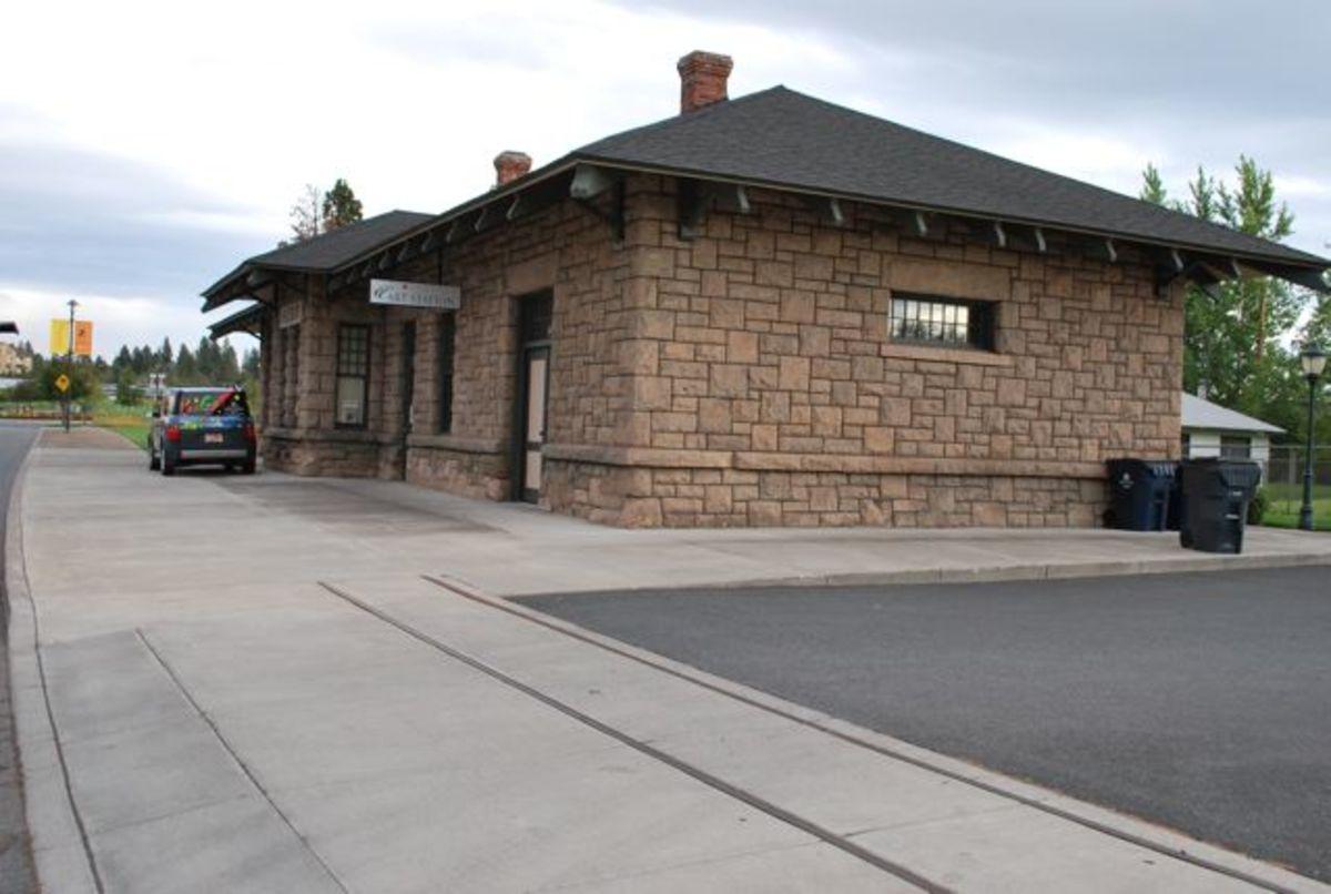 Railroad tracks in the sidewalk near the historic train station in Bend (c) Stephanie Hicks