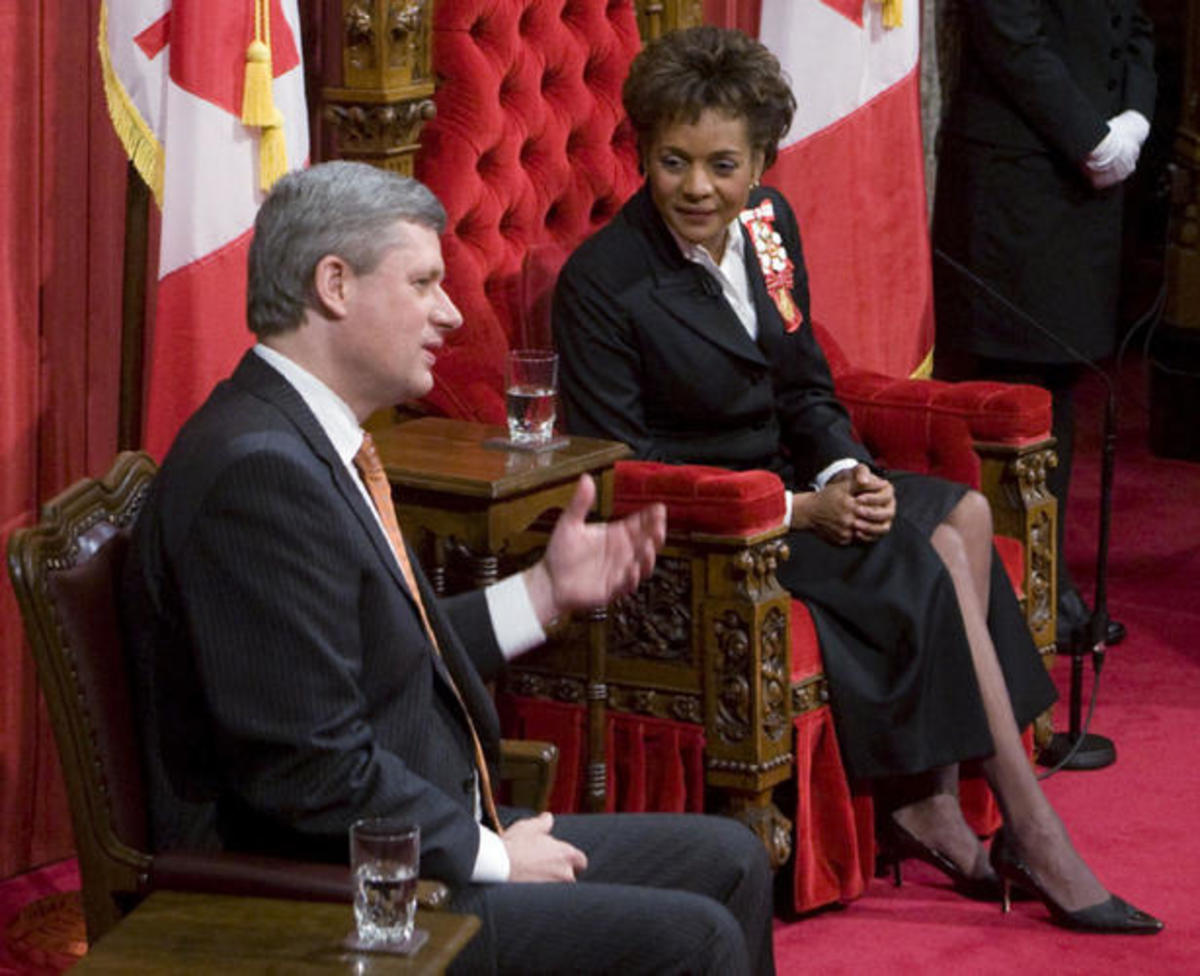 Governor General Michaelle Jean and Prime Minister Stephen harper chat prior to the reading of the Throne Speech in the Senate Chamber on Parliament Hill in Ottawa Wednesday Nov 19, 2008