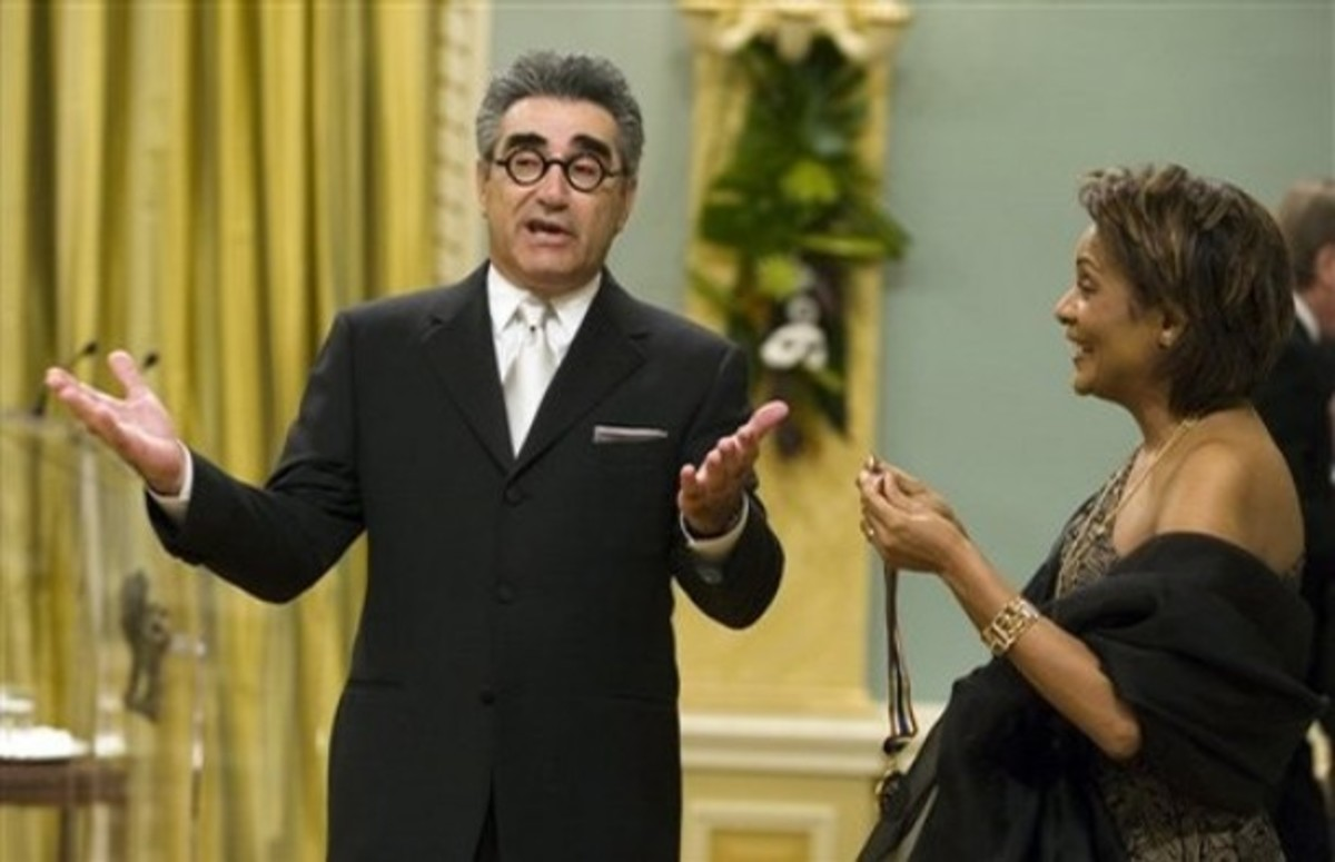 Actor and comedian Eugene Levy shares a light moment as he is presented with Lifetime Artistic Achievement award in the Performing Arts by Governor General Michalle Jean at Rideau Hall in Ottawa, 2 May 2008