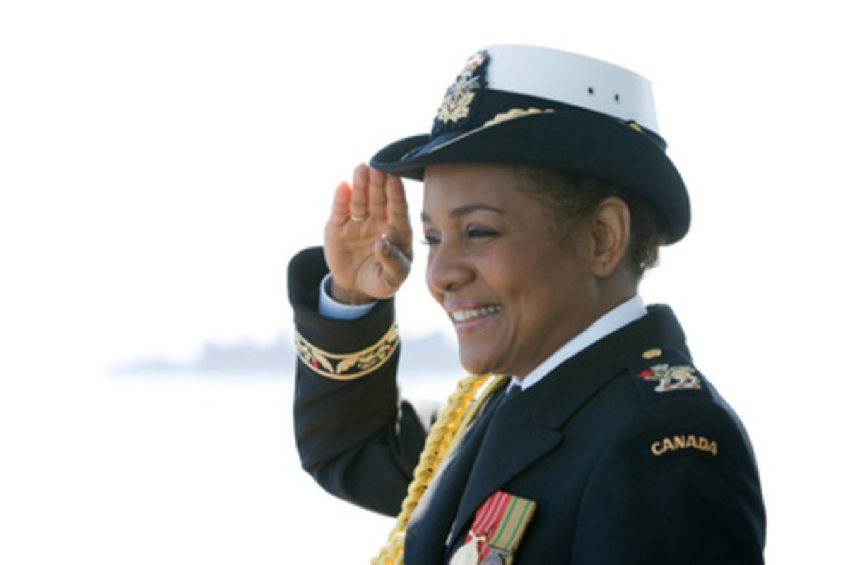 Governor General and Commander-in-Chief of the Canadian Forces Michalle Jean salutes on the HMCS Algonquin destroyer in Victoria, B.C. on Saturday during an international fleet review celebrating 100 years of the Navy in Canada,  June 2010