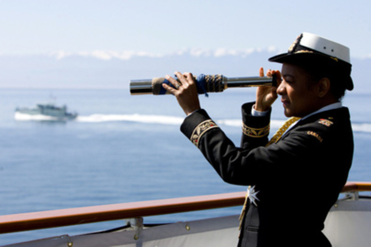 Governor General and Commander-in-Chief of the Canadian Forces Michalle Jean uses a spyglass on the HMCS Algonquin destroyer in Victoria, B.C. , June 2010