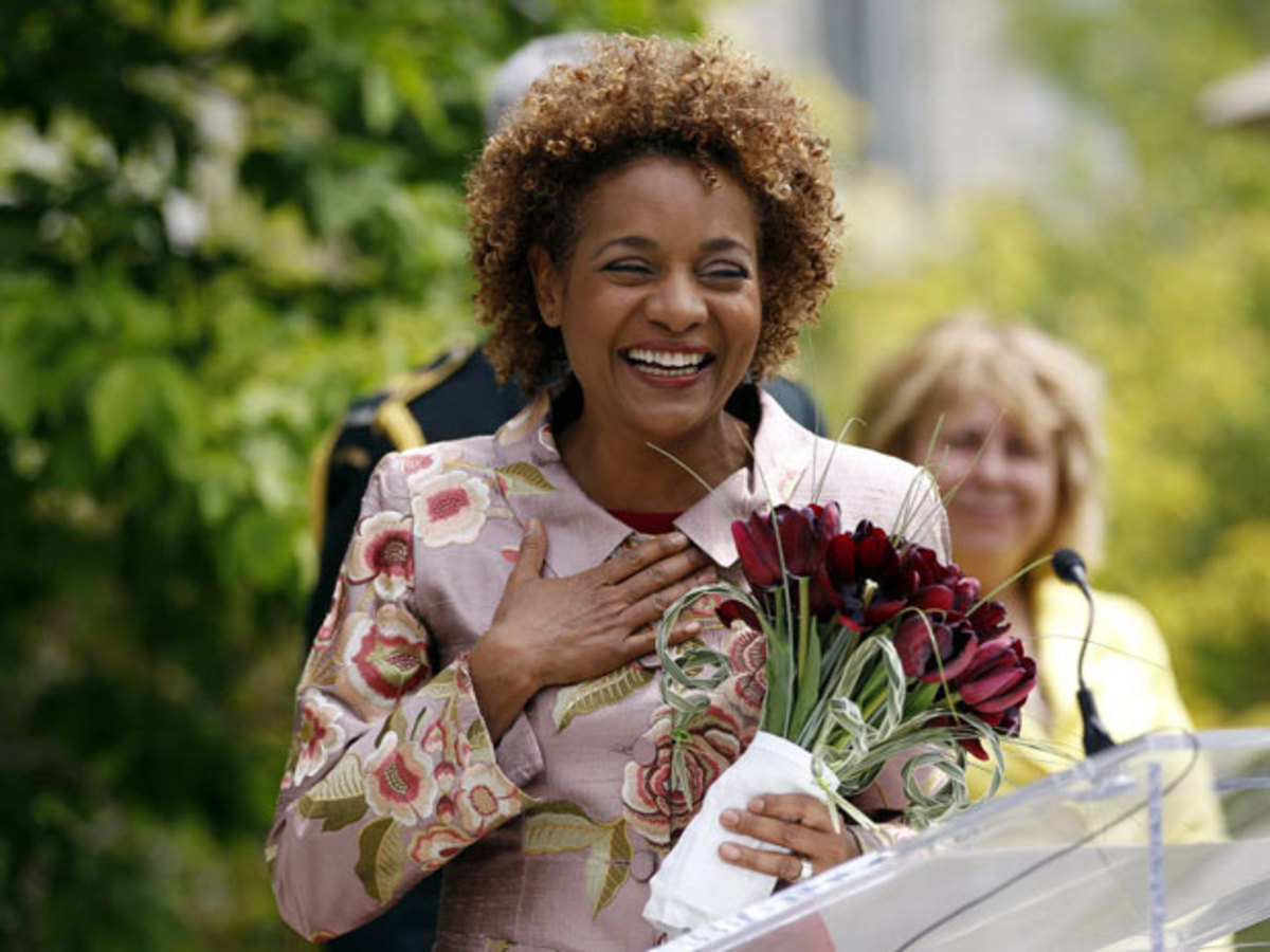 Michaelle Jean accepts a bouquet of tulips named after her