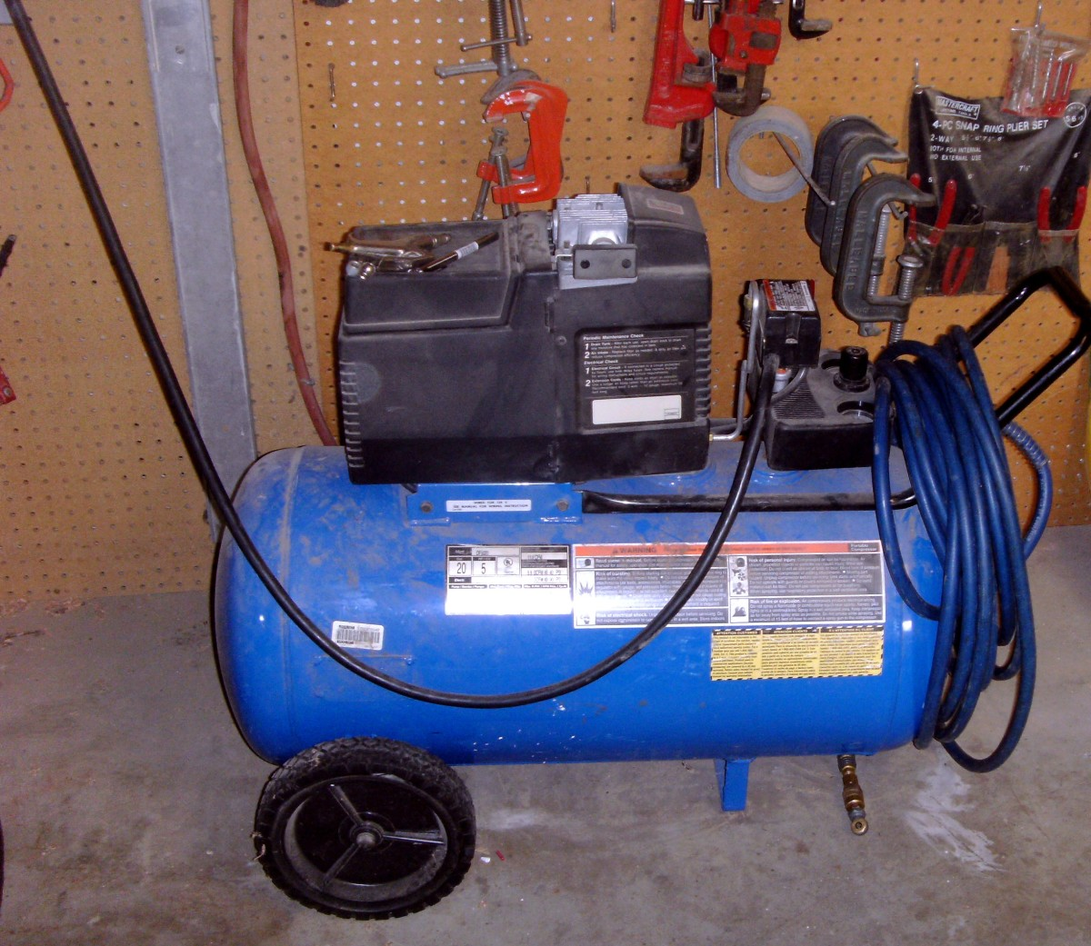 My own Devilbiss air compressor.  Note the small tray on the upper left for accessories.  This is a 5 HP, 20 gallon compressor producing 7 CFM at 90 PSI.